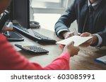 businessman receiving money in... | Shutterstock . vector #603085991