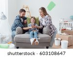 happy family holding a model... | Shutterstock . vector #603108647