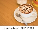 a cup of coffee on wooden... | Shutterstock . vector #603109421