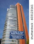 Small photo of VIENNA, AUSTRIA - AUGUST 14, 2016: Aristides de Sousa Mendes Promenade street name sign in front of Andromeda Tower at the Austria Center Vienna (ACV).