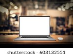 laptop with blank screen on... | Shutterstock . vector #603132551
