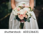 bride in a white dress is... | Shutterstock . vector #603136631