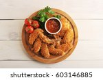 fried chicken wings breaded... | Shutterstock . vector #603146885
