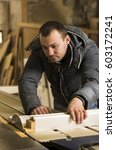 man doing some carpentry work... | Shutterstock . vector #603172241