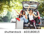 two young women with suitcases... | Shutterstock . vector #603180815
