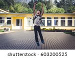 happy kid with backpack jumping ... | Shutterstock . vector #603200525