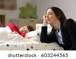 tired worker mother wearing... | Shutterstock . vector #603244565