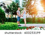 a happy young modern couple... | Shutterstock . vector #603253199