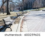 wooden benches along a paved... | Shutterstock . vector #603259631