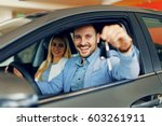 young couple holding the keys... | Shutterstock . vector #603261911