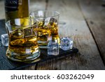 whiskey with ice in glasses | Shutterstock . vector #603262049