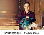 smiling workman dressed in the...   Shutterstock . vector #603291011