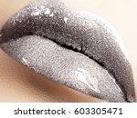 close up of liquid silver woman ... | Shutterstock . vector #603305471