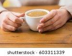 enjoy cup of coffee. woman... | Shutterstock . vector #603311339