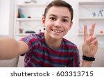happy teenager making selfie... | Shutterstock . vector #603313715