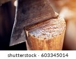 Slitting Wood With An Axe....