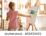 cute little artist painting... | Shutterstock . vector #603432431