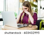 frustrated young woman keeping... | Shutterstock . vector #603432995
