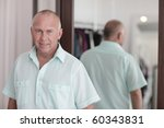 modern man by the mirror | Shutterstock . vector #60343831