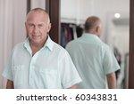 modern man by the mirror | Shutterstock . vector #60343831