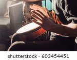 playing the drum. hands with a... | Shutterstock . vector #603454451