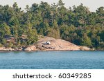 White tent on rocky island - stock photo