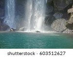 a falling waterfall and the... | Shutterstock . vector #603512627