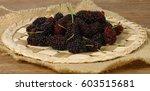 fresh mulberries on wooden...   Shutterstock . vector #603515681