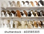 row of mannequin heads with...   Shutterstock . vector #603585305