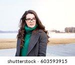girl in coat and glasses walks...   Shutterstock . vector #603593915