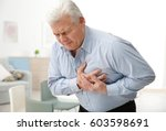 man with chest pain suffering... | Shutterstock . vector #603598691