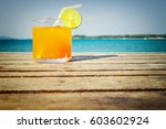 orange in glass on summer time... | Shutterstock . vector #603602924