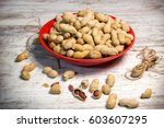 peanuts in shell  in bowl on... | Shutterstock . vector #603607295