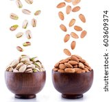almonds and pistachios falling... | Shutterstock . vector #603609374