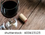 glass of wine on wooden table... | Shutterstock . vector #603615125