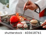 hand holding chef pincers ... | Shutterstock . vector #603618761