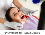 beautiful girl treats teeth in... | Shutterstock . vector #603625691