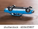 close up of a crashed toy car... | Shutterstock . vector #603635807
