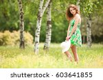 young redhead woman walking in... | Shutterstock . vector #603641855