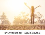 a happy girl is standing in a... | Shutterstock . vector #603668261