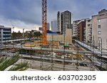 Small photo of Construction site in the middle of developed suburb in Sydney city as respond to high demand in affordable new quality houses and apartments.