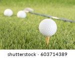 golf ball sitting on tee... | Shutterstock . vector #603714389