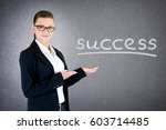 business lady pointing at... | Shutterstock . vector #603714485