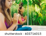 young women practicing yoga...