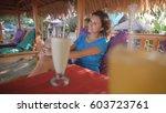 young beautiful brunette is... | Shutterstock . vector #603723761