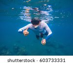 young sportsman in snorkeling... | Shutterstock . vector #603733331