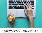 office worker typing email on... | Shutterstock . vector #603744017