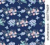 flowery tracery pattern in... | Shutterstock .eps vector #603779609