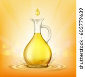 glass jug with yellow oil and a ... | Shutterstock .eps vector #603779639