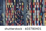 Small photo of Top view aerial photo of stack of freight containers in rows at the shipyard. Big harbor with anchored track vehicles. Global Logistics Shipping industry. Export and Import transportation services